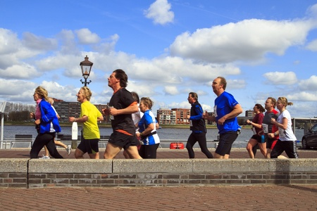DORDRECHT, NETHERLANDS - APRIL 1 2012: The 65th edition �Dwars door Dort� on Sunday 1 April 2012. Contenders running in the sunshine next to the river