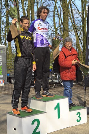 DORDRECHT, NETHERLANDS - APRIL 14 2012: Run Bike Run Bike Run duathlon event. Dirk Londema and Alexander Picard receiving their prize on the winners podium on Saturday 14 April 2012 in Dordrecht.