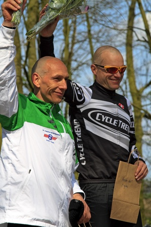 DORDRECHT, NETHERLANDS - APRIL 14 2012: Run Bike Run Bike Run duathlon event. John Aalbers and Armand van der Smissen celebrating their win on Saturday 14 April 2012 in Dordrecht. Stock Photo - 13257715