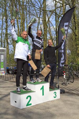 DORDRECHT, NETHERLANDS - APRIL 14 2012: Run Bike Run Bike Run duathlon event. John Aalbers, Armand van der Smissen and Remco Grasman celebrate their win on Saturday 14 April 2012 in Dordrecht. Stock Photo - 13257743