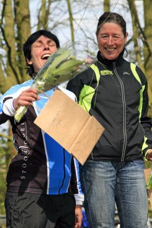 DORDRECHT, NETHERLANDS - APRIL 14 2012: Run Bike Run Bike Run duathlon event. Margriet Uil and Monique Haans on the winners podium of the dualthlon on Saturday 14 April 2012 in Dordrecht.