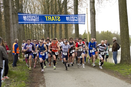 DORDRECHT, NETHERLANDS - APRIL 14 2012: Run Bike Run Bike Run duathlon event. Competitors begin the dualthlon on Saturday 14 April 2012 in Dordrecht. Editorial
