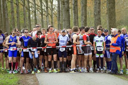 dordrecht: DORDRECHT, NETHERLANDS - APRIL 14 2012: Run Bike Run Bike Run duathlon event. Competitors lining up at the start of the race on Saturday 14 April 2012 in Dordrecht. Editorial