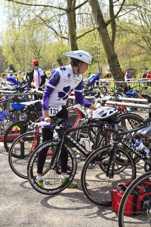 DORDRECHT, NETHERLANDS - APRIL 14 2012: Run Bike Run Bike Run duathlon event. Contestant, Alexander Picard arriving with his bike before the race on Saturday 14 April 2012 in Dordrecht. Stock Photo - 13257740