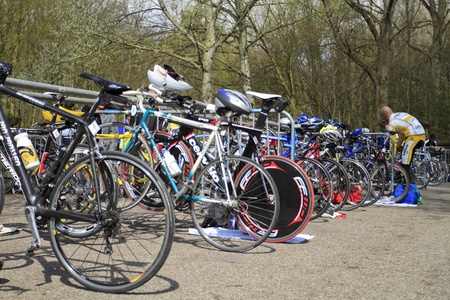 DORDRECHT, NETHERLANDS - APRIL 14 2012: Run Bike Run Bike Run duathlon event. Competition bikes stacked up in a row before the race on Saturday 14 April 2012 in Dordrecht. Stock Photo - 13257744