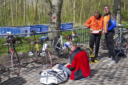 DORDRECHT, NETHERLANDS - APRIL 14 2012: Run Bike Run Bike Run duathlon event. Competitors arriving and getting ready for the race on Saturday 14 April 2012 in Dordrecht. Stock Photo - 13257739