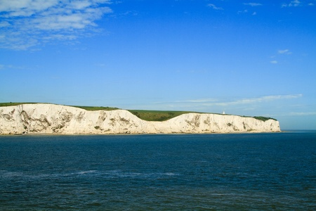 Landscape view of white cliffs of Dover from the sea photo