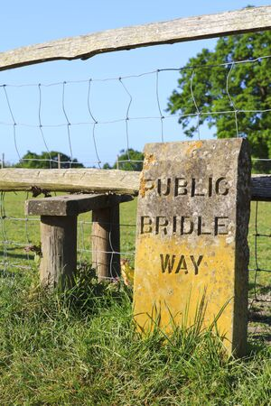 Engraved stone sign for a public bridleway in the countryside photo