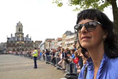 DELFT, NETHERLANDS - MAY 17 2012: The 25th edition Trompper Optiek Golden Tenloop on Thursday 17 May 2012. Spectators waiting in anticipation on the market square in Delft Stock Photo - 13745354