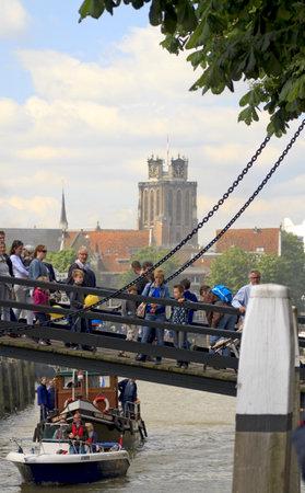 dordrecht: DORDRECHT, NETHERLANDS - JUNE 2 2012: Dordrecht in Steam, the largest steam power event in Europe. Visitors crossing the bridge on Saturday 2 June 2012 in Dordrecht.