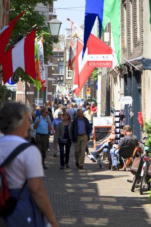 dordrecht: DORDRECHT, NETHERLANDS - JUNE 2 2012: Dordrecht in Steam, the largest steam power event in Europe. Visitors shopping on Vleeshouwers Street on Saturday 2 June 2012 in Dordrecht. Editorial