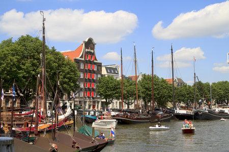 dordrecht: DORDRECHT, NETHERLANDS - JUNE 2 2012: Dordrecht in Steam, the largest steam power event in Europe. Many historic boats in Wolwevershaven harbor on Saturday 2 June 2012 in Dordrecht.