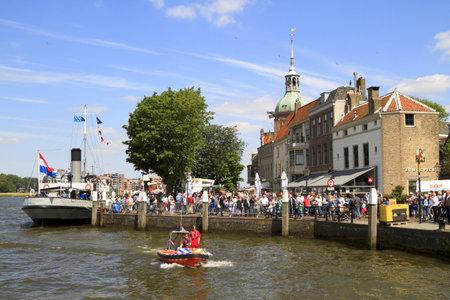 dordrecht: DORDRECHT, NETHERLANDS - JUNE 2 2012: Dordrecht in Steam, the largest steam power event in Europe. Festival visitors on the Groot Hoofd on Saturday 2 June 2012 in Dordrecht. Editorial