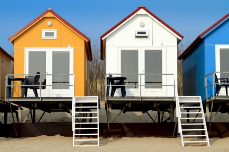 Yellow blue and white beach houses in Vlissingen Editorial