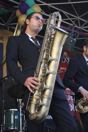 DORDRECHT, NETHERLANDS - JULY 15: Koen Schouten plays baritone sax on stage for The Jig at the Big Rivers Festival on Sunday 15 July 2012 in Dordrecht.