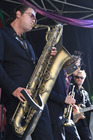 DORDRECHT, NETHERLANDS - JULY 15: Koen Schouten plays baritone sax with band members from The Jig at the Big Rivers Festival on Sunday 15 July 2012 in Dordrecht.