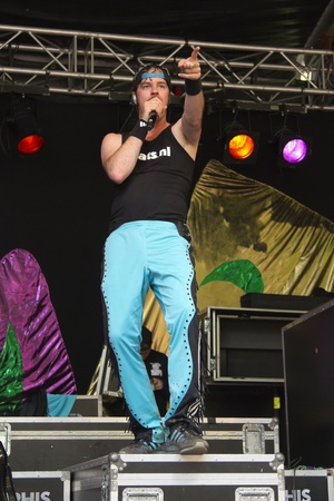 DORDRECHT, NETHERLANDS - JULY 15: Rocky van Bree, pointing to the audience while singing on stage for the Memphis Maniacs at the Big Rivers Festival on Sunday 15 July 2012 in Dordrecht.