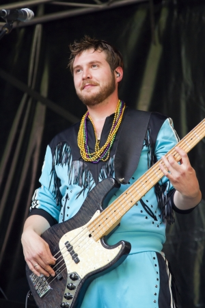 DORDRECHT, NETHERLANDS - JULY 15: Lary Simmons plays bass guitar while on stage for Memphis Maniacs at the Big Rivers Festival on Sunday 15 July 2012 in Dordrecht.