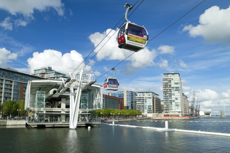 LONDON, UK - AUG 4: Visitors travel on the Emirates cable car. The service is London?s first urban cable car which crosses the Thames from Excel centre to the O2 on August 4, 2012 in London UK Editorial