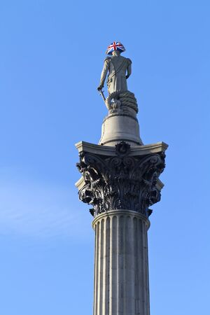 Statue of Nelsons column on trafalgar square in london wearing a union jack hat photo