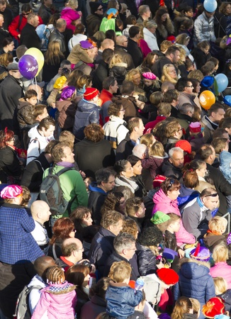 DORDRECHT, NETHERLANDS - NOVEMBER 12: Crowd of adults and children waiting for arrival of St Nicolas. He will travel all over the country and hand out sweets on Nov 12, 2011 in Dordrecht, Netherlands. Editorial