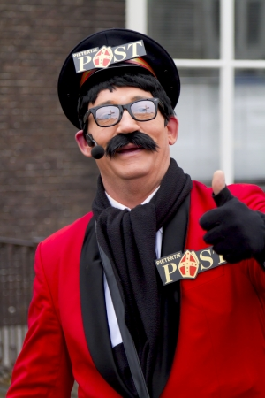 DORDRECHT, THE NETHERLANDS - NOVEMBER 18: Man dressed as the postman of Santa Claus giving a thumbs up to the public on November 18, 2012 in Dordrecht, Netherlands.