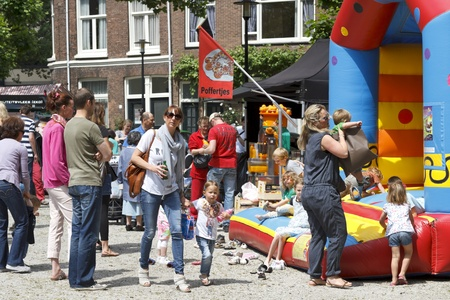 DORDRECHT, NETHERLANDS - JUNE 30, 2013: Parents with children playing at the Swan Market in Dordrecht. The lifestyle market was first held in Rotterdam in the winter of 2010 and known for its fun.