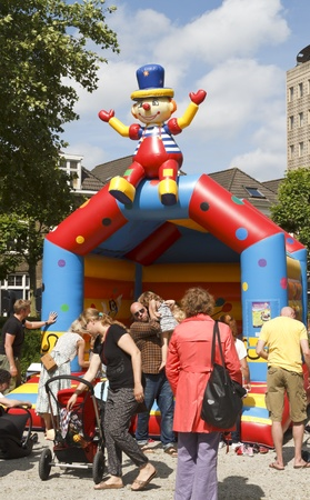 DORDRECHT, NETHERLANDS - JUNE 30: Parents with children playing at the Swan Market on June 30, 2013 in Dordrecht. The lifestyle market was first held in Rotterdam in 2010 and is known for its fun.