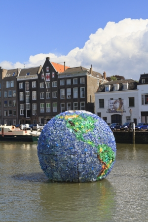 DORDRECHT, NETHERLANDS - AUGUST 11  Big plastic globe, named World Litter, made from 6000 plastic bottles on August 11, 2013 in Dordrecht  Aim is to draw attention to the problem of litter in the sea