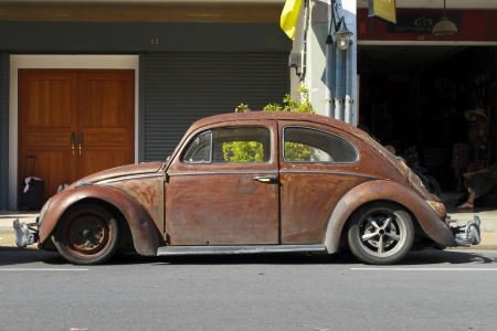 Phuket, Thailand - February 8, 2012  Old beat-up rusty brown customized Volkswagen Beetle parked in the street of the old city on February 8, 2012 in Phuket Town, Thailand Editorial