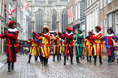 DORDRECHT, THE NETHERLANDS - NOVEMBER 17  Dancers dressed as Zwarte Piet participating in a parade celebrating the arrival of Saint Nicholas on November 17, 2012 in Dordrecht, Netherlands