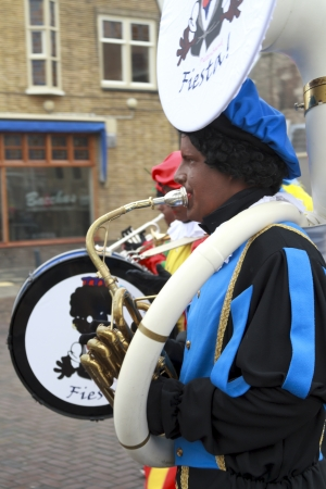 DORDRECHT, THE NETHERLANDS - NOVEMBER 17  Marching band dressed as Zwarte Piet participating in a parade celebrating the arrival of Saint Nicholas on November 17, 2012 in Dordrecht, Netherlands