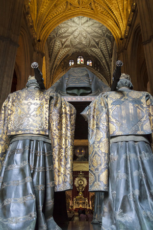 heralds: SEVILLE, SPAIN-MAY 8, 2013 Tomb of Christopher Columbus, crypt statues seen from behind, in Seville Cathedral in Andalusia where heralds dressed in full court mourning carry the sarcophagus
