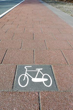 bicycle lane: A tiled bicycle lane with a retro bike symbol imprint