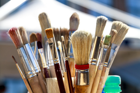 Various paintbrushes soiled with paint