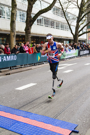 Rotterdam, The Netherlands – April 11, 2010  Athlete, Richard Whitehead, on his prosthetic legs crossing the line in the Rotterdam city marathon  The Netherlands biggest one-day sports event
