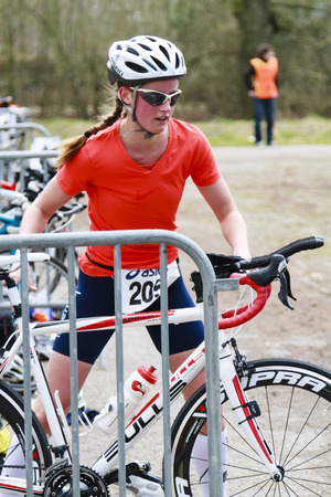 DORDRECHT, NETHERLANDS - APRIL 13 2013  Run Bike Run Bike Run duathlon event organised by TVD  Young contender changes over to cycling stage on the course of the dualthlon just outside Dordrecht