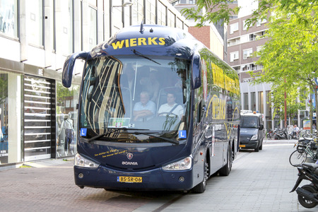 DORDRECHT, NETHERLANDS - MAY 20 2014  FC Dordrecht soccer players arriving in the players bus with police escort to celebrate the promotion to Eredivisie soccer competition in The Netherlands