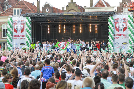 DORDRECHT, NETHERLANDS - MAY 20 2014  FC Dordrecht soccer players celebrating with cup on stage as fans cheer on to celebrate the promotion to Eredivisie soccer competition in The Netherlands  Editorial