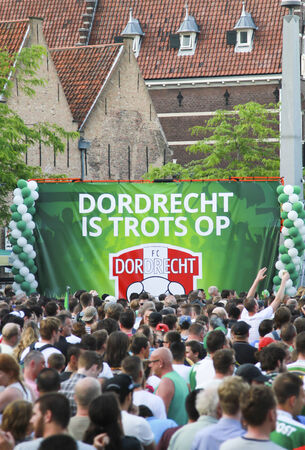 DORDRECHT, NETHERLANDS - MAY 20 2014  Crowds gather dressed in green on central square to celebrate and honor the winners of the soccer Jupiler League in The Netherlands, FC Dordrecht
