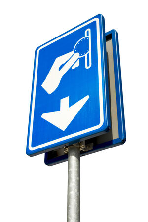 Isolated blue and white parking pay here sign with arrow against a cloudy blue sky photo