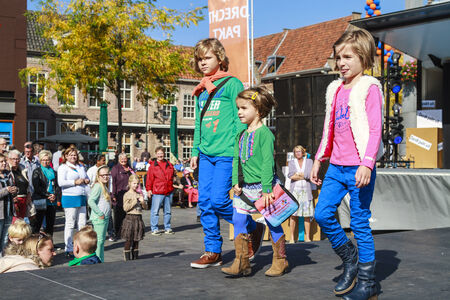 DORDRECHT, NETHERLANDS – SEPTEMBER 29 2013  Free entertainment and fashion show in the main square organized by the municipality  Child models walk on the catwalk showcasing the new autumn collection  Redakční