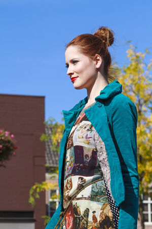 DORDRECHT, NETHERLANDS - SEPTEMBER 29 2013: Free entertainment and fashion show in the main square organized by the municipality. Red haired model on catwalk showcasing the new autumn collection.