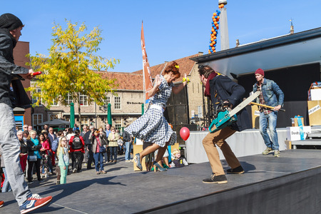 DORDRECHT, NETHERLANDS - SEPTEMBER 29 2013: Free entertainment and fashion show in the main square organized by the municipality. Male models entertain on the catwalk showcasing the autumn collection. Redakční