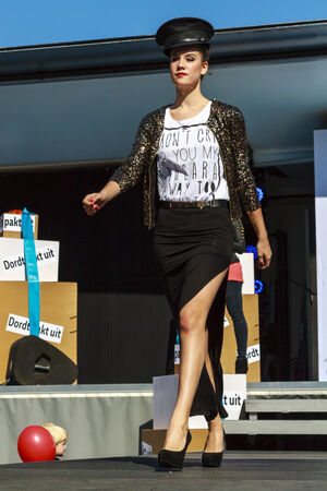DORDRECHT, NETHERLANDS - SEPTEMBER 29 2013: Free entertainment and fashion show in the main square organized by the municipality. Model walking on the catwalk showcasing the new autumn collection.