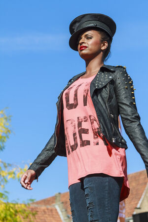DORDRECHT, NETHERLANDS – SEPTEMBER 29 2013: Free entertainment and fashion show in the main square organized by the municipality. Model walking on the catwalk showcasing the new collection.