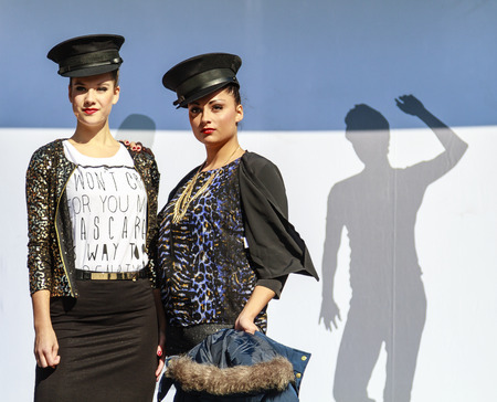 DORDRECHT, NETHERLANDS - SEPTEMBER 29 2013: Free entertainment and fashion show in the main square organized by the municipality. Two models standing on the catwalk showcasing the new collection. Redakční