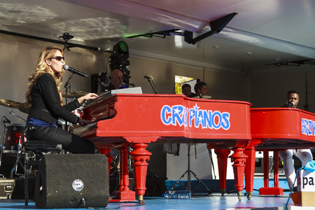 DORDRECHT, NETHERLANDS - SEPTEMBER 29 2013: Free entertainment and music on stage in the main square organized by the municipality. Jennifer Lynn playing duo with Crazy Pianos pianist Stevie J.