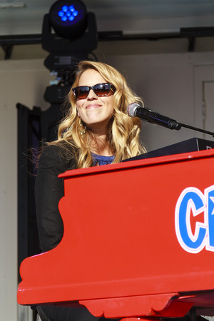 DORDRECHT, NETHERLANDS - SEPTEMBER 29 2013: Free entertainment and music on stage in the main square organized by the municipality. Jennifer Lynn, Crazy Pianos pianist playing and smiling on stage. Redakční