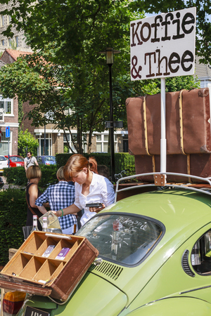 DORDRECHT, NETHERLANDS - AUGUSTUS 10, 2014: Pouring coffee, serving drinks out of a car at the summer Swan Market in Dordrecht. The lifestyle market was originally started in vacant shops in Rotterdam